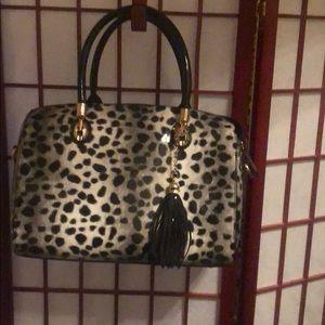 Black leopard spotted bag vinyl plastic